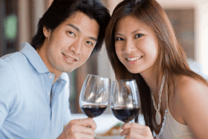 Asian couple sharing a drink