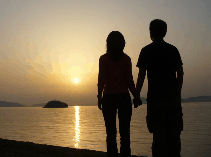 A couple standing at the sunset
