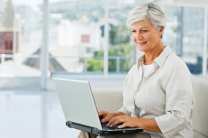 Senior lady dating online on her laptop
