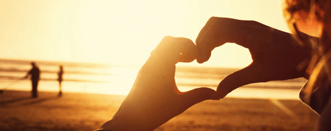 Love gesture symbolizing summer love