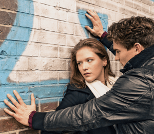 A woman pushed to the wall by her agressive partner