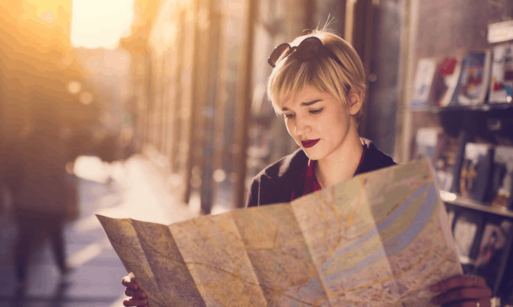 Women looking at a map to find her date in a foreign city